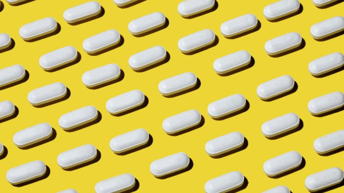 White pills on a yellow background