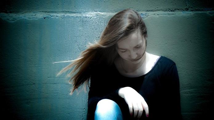 photo of girl sitting alone