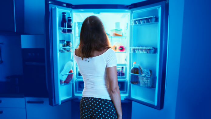 Woman looking into the refrigerator