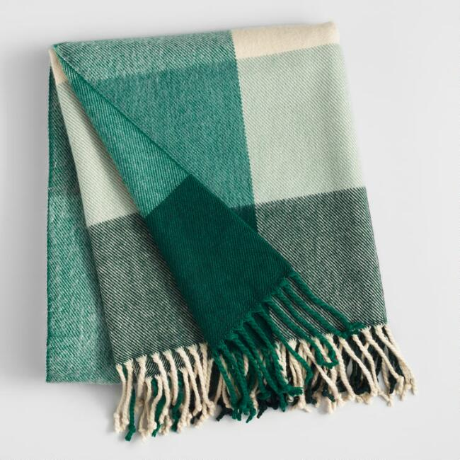 Green and ivory plaid throw blanket.