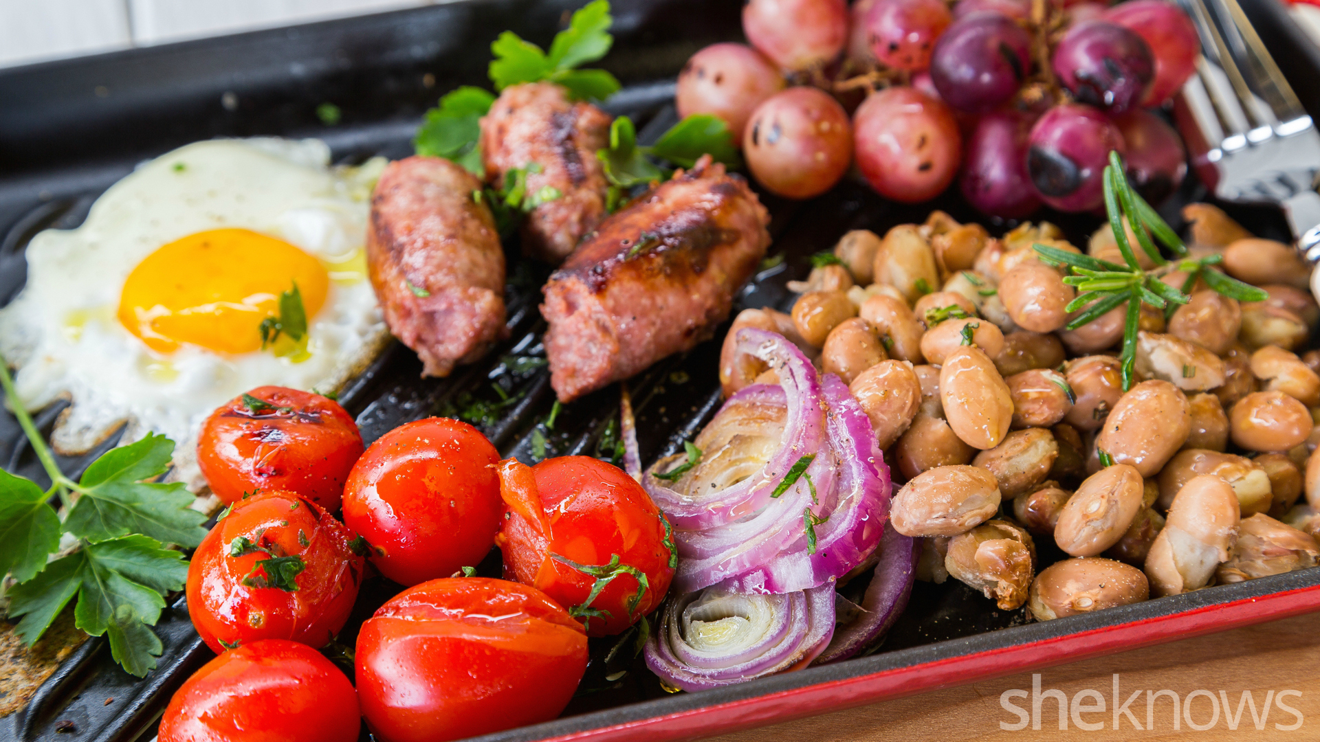 One-Skillet beakfast with sausages, beans, roasted grapes and tomatoes
