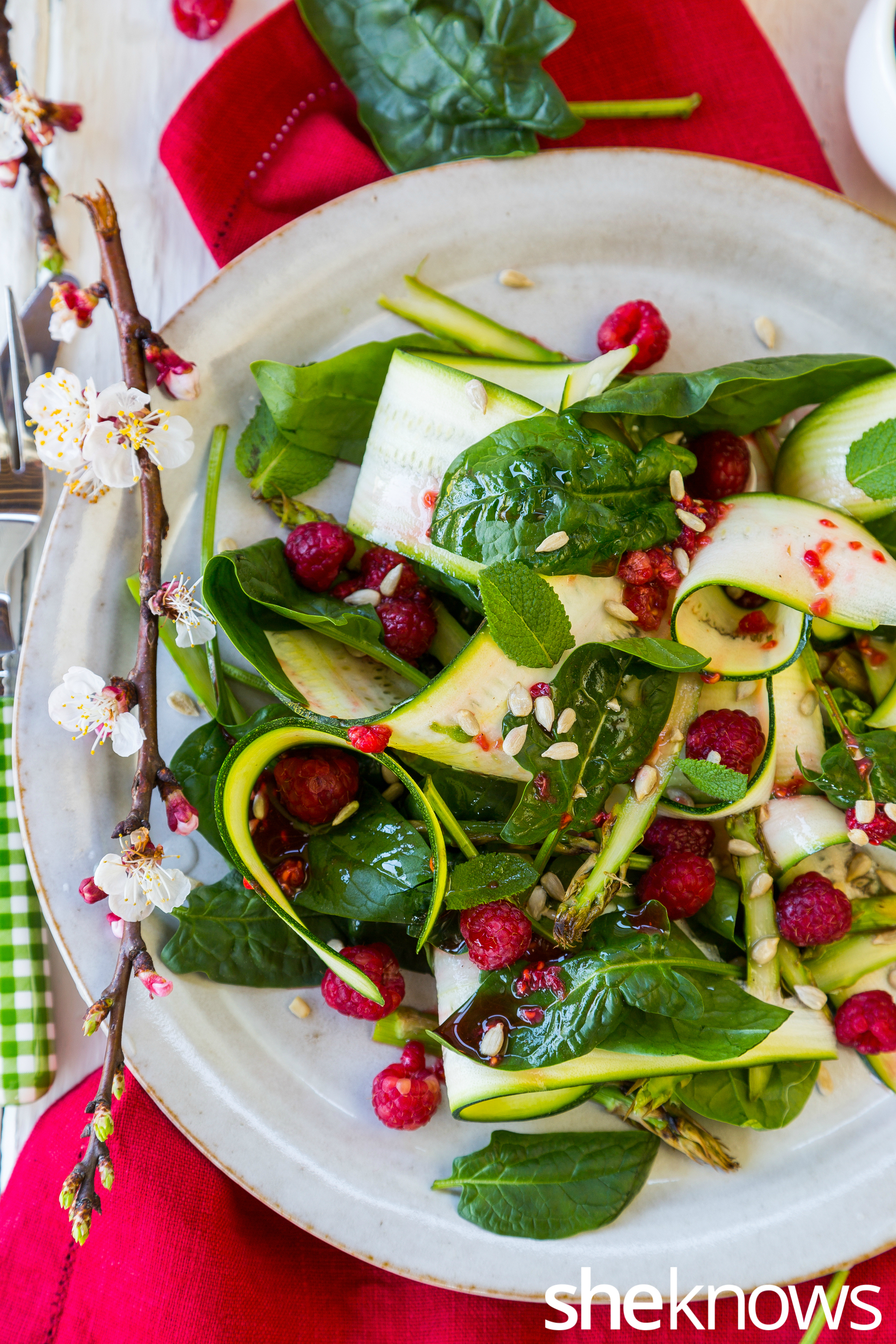 Spring green salad with crushed raspberry dressing