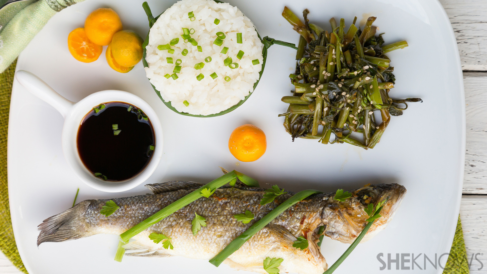 Asian meal: Fried whole fish, adobo water spinach and steamed rice