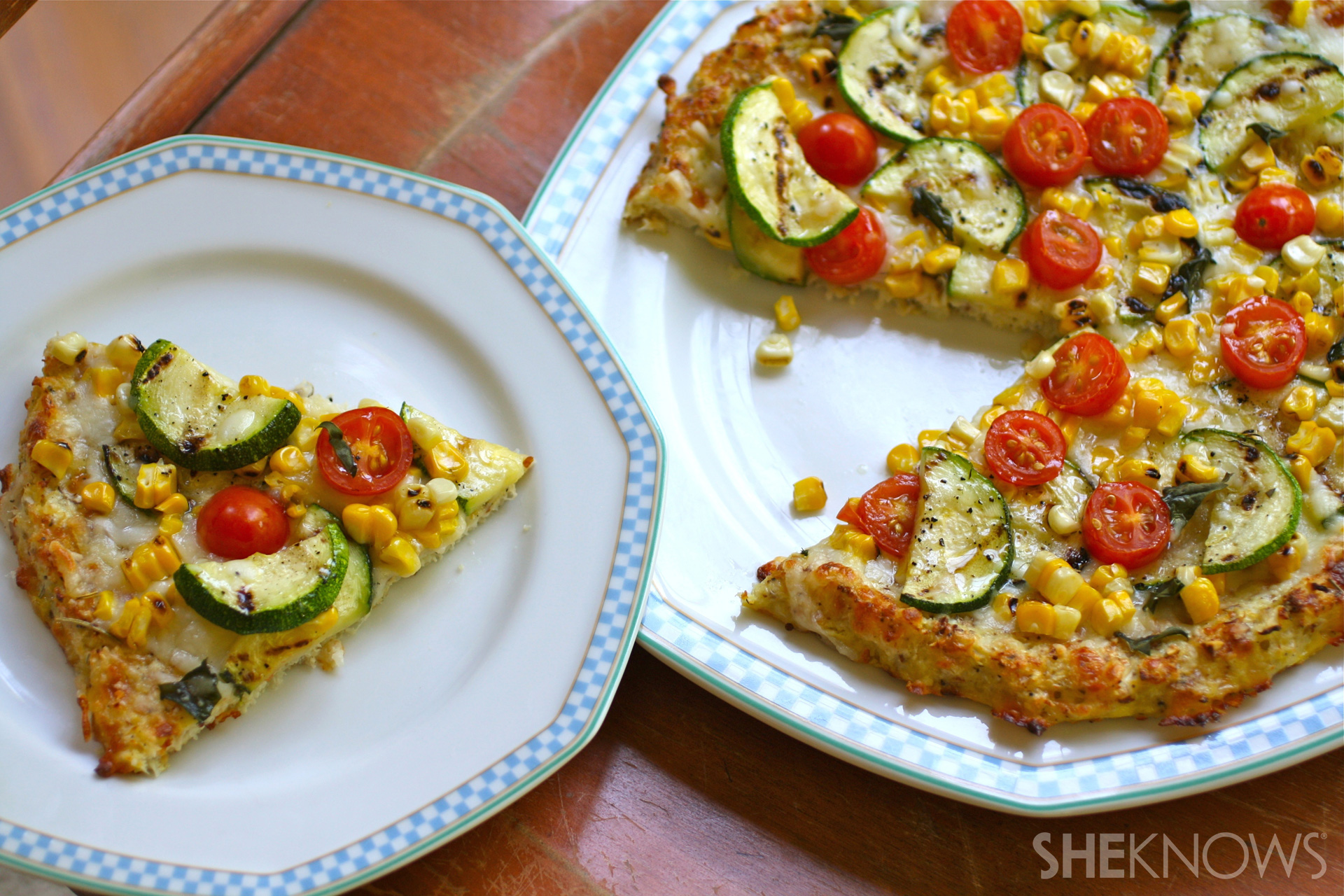 Cauliflower crust pizza with grilled corn, zucchini, and tomatoes