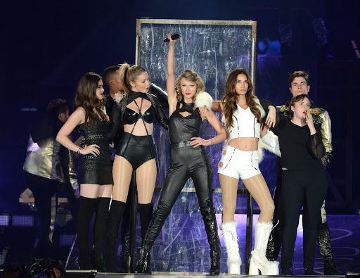 Lena Dunham on stage with Taylor Swift