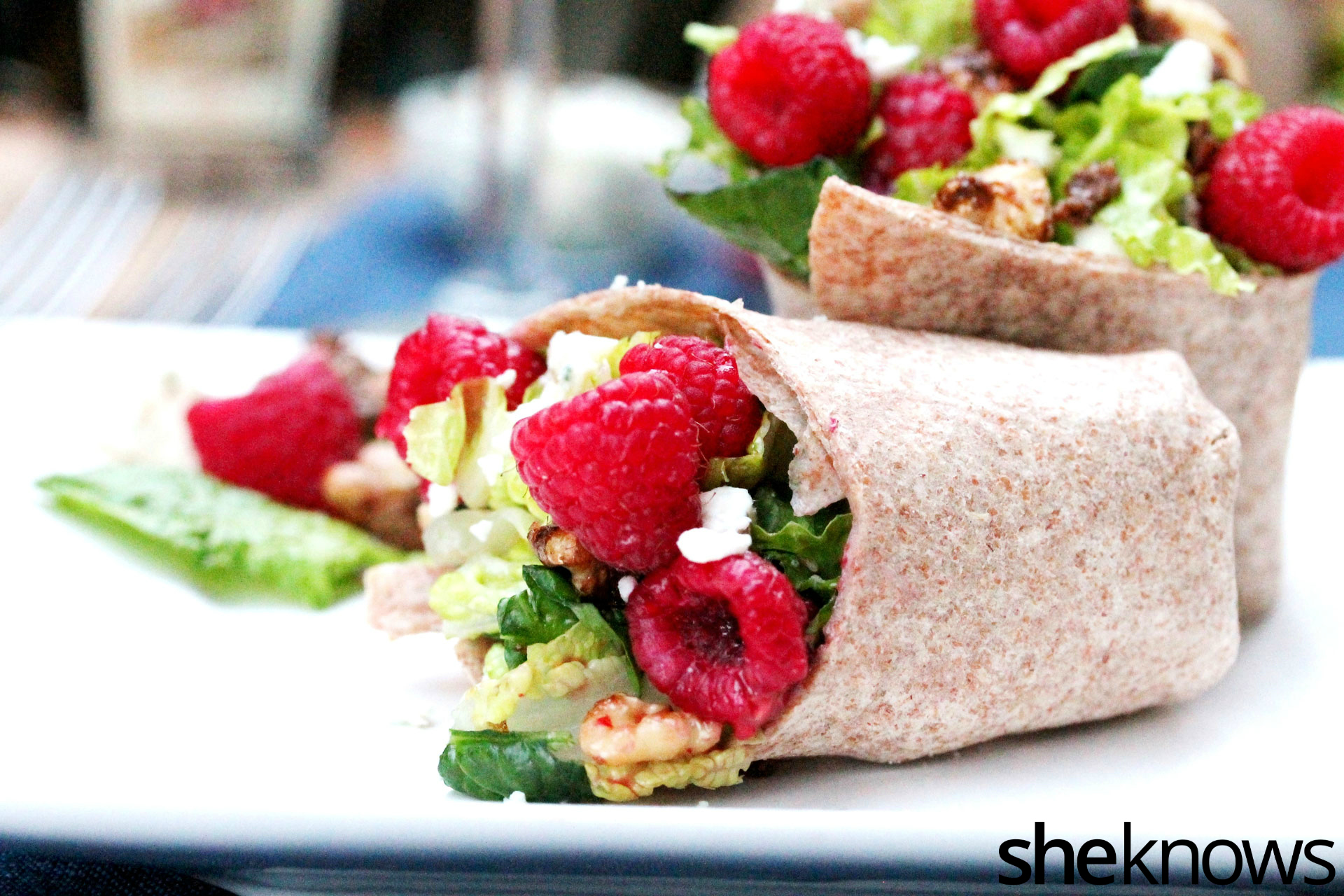 Raspberry and spinach wrap on plate