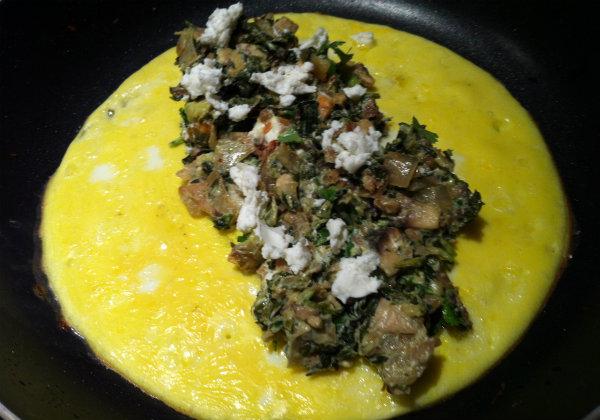 Add veggies to eggs