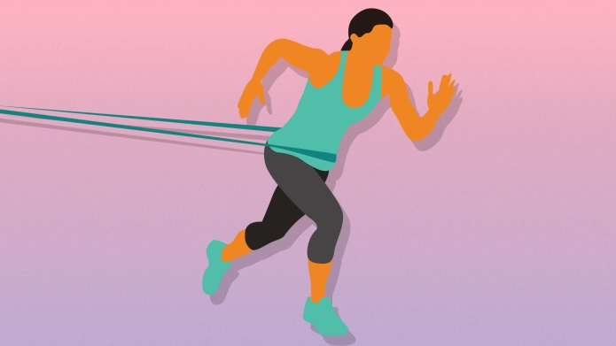 Woman running with resistance band
