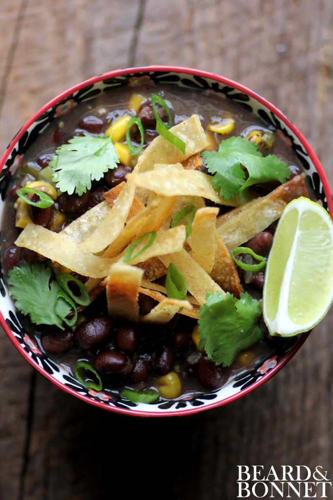 Black bean and fire roasted corn chili with cumin dusted tortilla strips