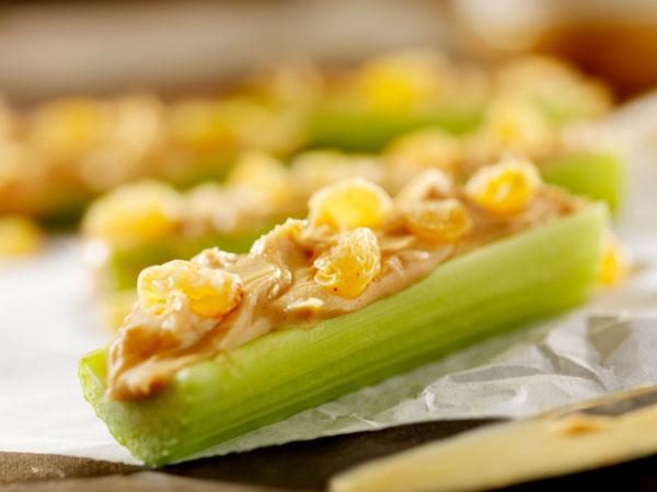 Celery sticks, raisins and peanut butter