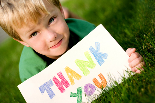 Boy holding up a thank you sign