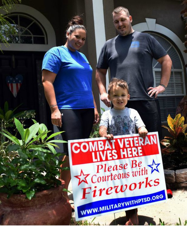Combat veteran with courtesy yard sign via Military with PTSD