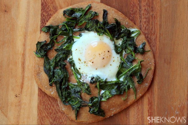 Egg and greens pizza