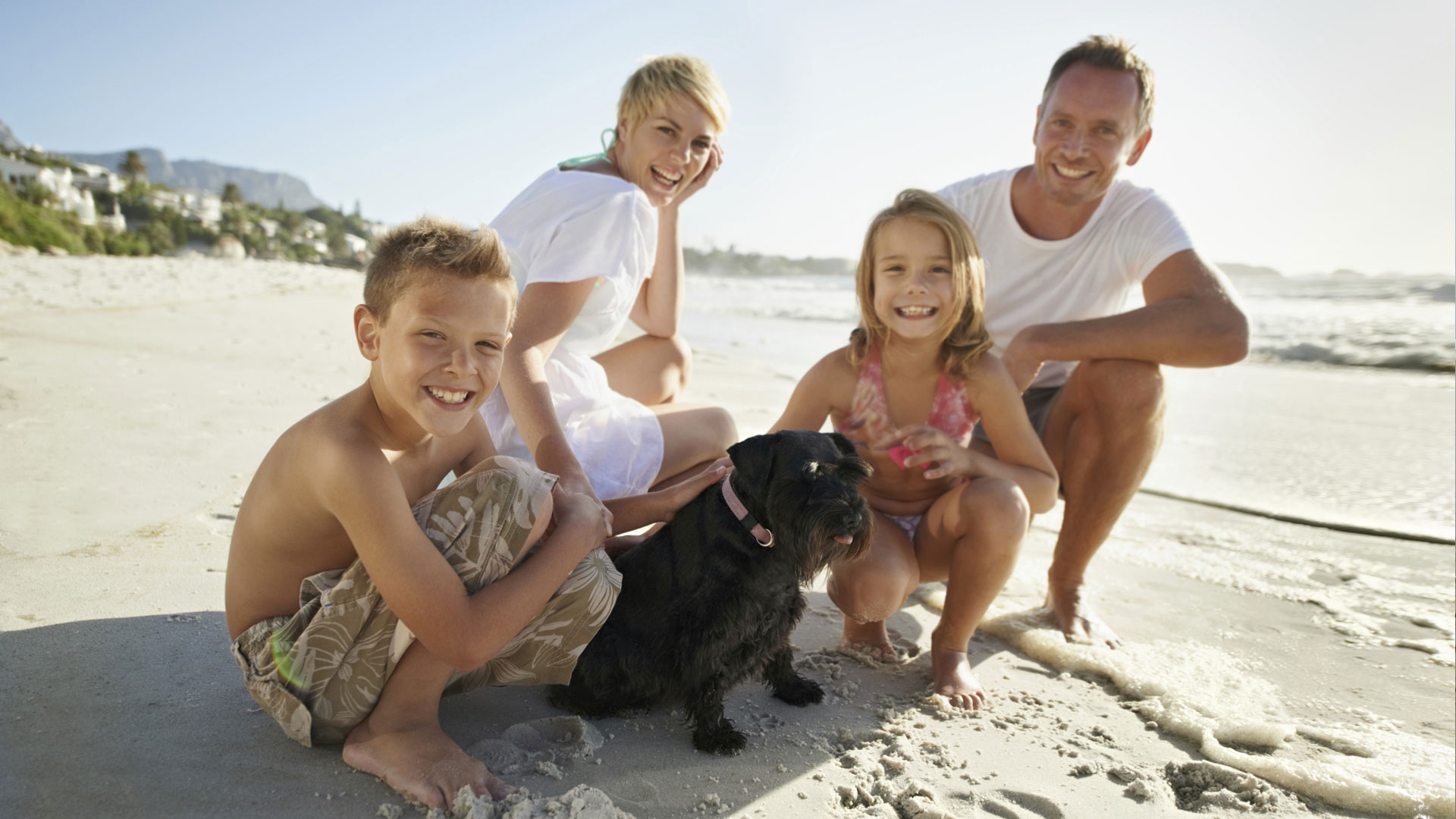 Family on vacation with family dog
