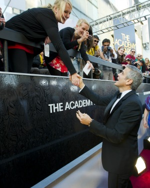 George Clooney signs autographs at the Oscars
