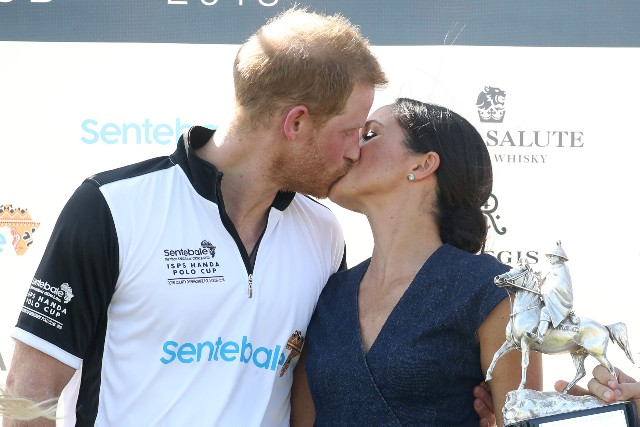 Meghan Duchess of Sussex and Prince Harry Duke of Sussex kiss after the Sentebale Polo 2018