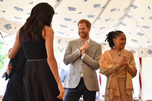 Meghan, Duchess of Sussex, Prince Harry, Duke of Sussex and Doria Ragland attend an event to mark the launch of a cookbook with recipes from a group of women affected by the Grenfell Tower fire at Kensington Palace