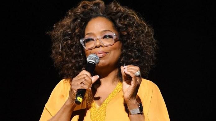 Oprah Winfrey, wearing Gert-Johan Coetzee, speaks