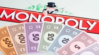 photo of Monopoly board and money