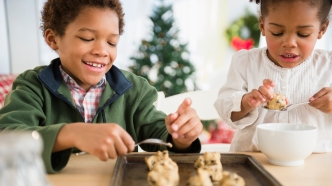 photo of children baking cookies together
