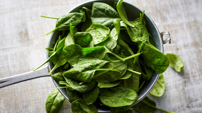 photo of fresh spinach leaves in