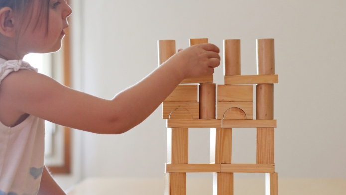 photo of Girl playing with Wooden