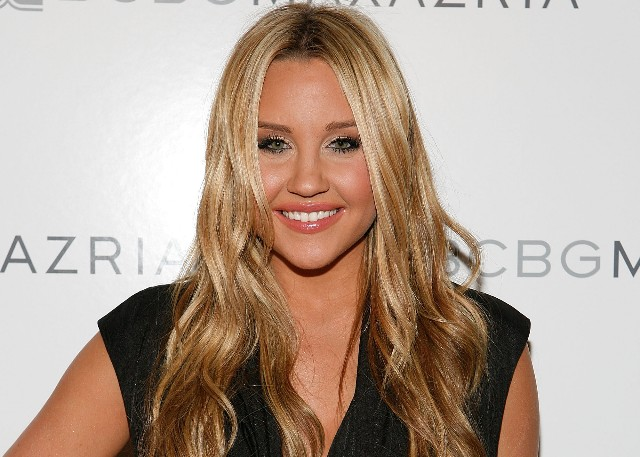 Amanda Bynes attends the BCBG Max Azria Spring 2010 Fashion Show at the Tent during Mercedes-Benz Fashion Week at Bryant Park