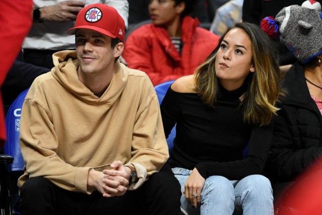 Grant Gustin and Andrea 'LA' Thoma attend a basketball game between the Los Angeles Clippers and the Minnesota Timberwolve