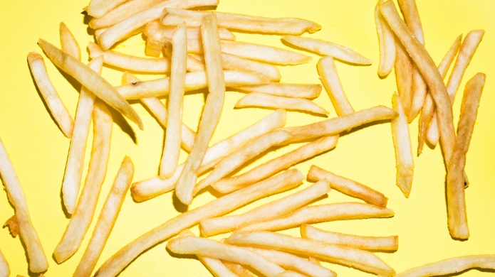 photo of french fries on yellow
