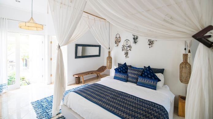 Cozy airy bedroom with blue pillows
