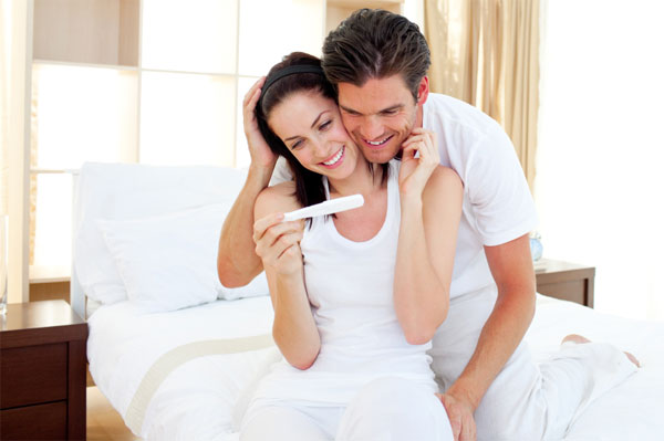 Happy couple finding out about pregnancy