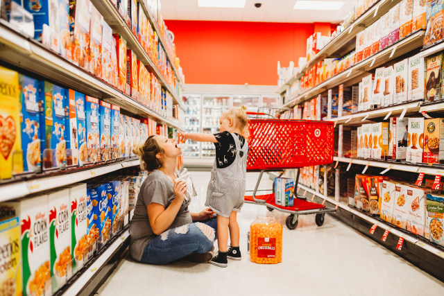 Mom and toddler doing photo shoot in Target.