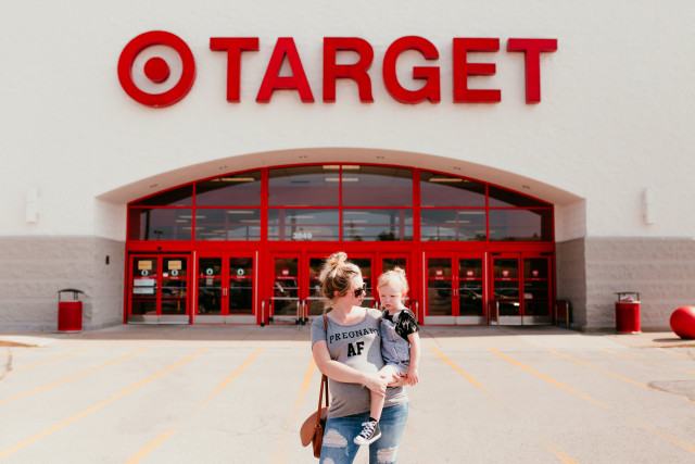 Mom and toddler doing photo shoot outside Target.