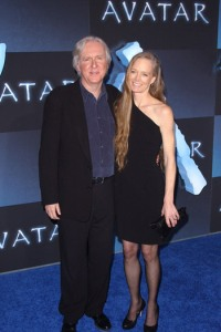 James Cameron and his wife walk the Avatar blue carpet