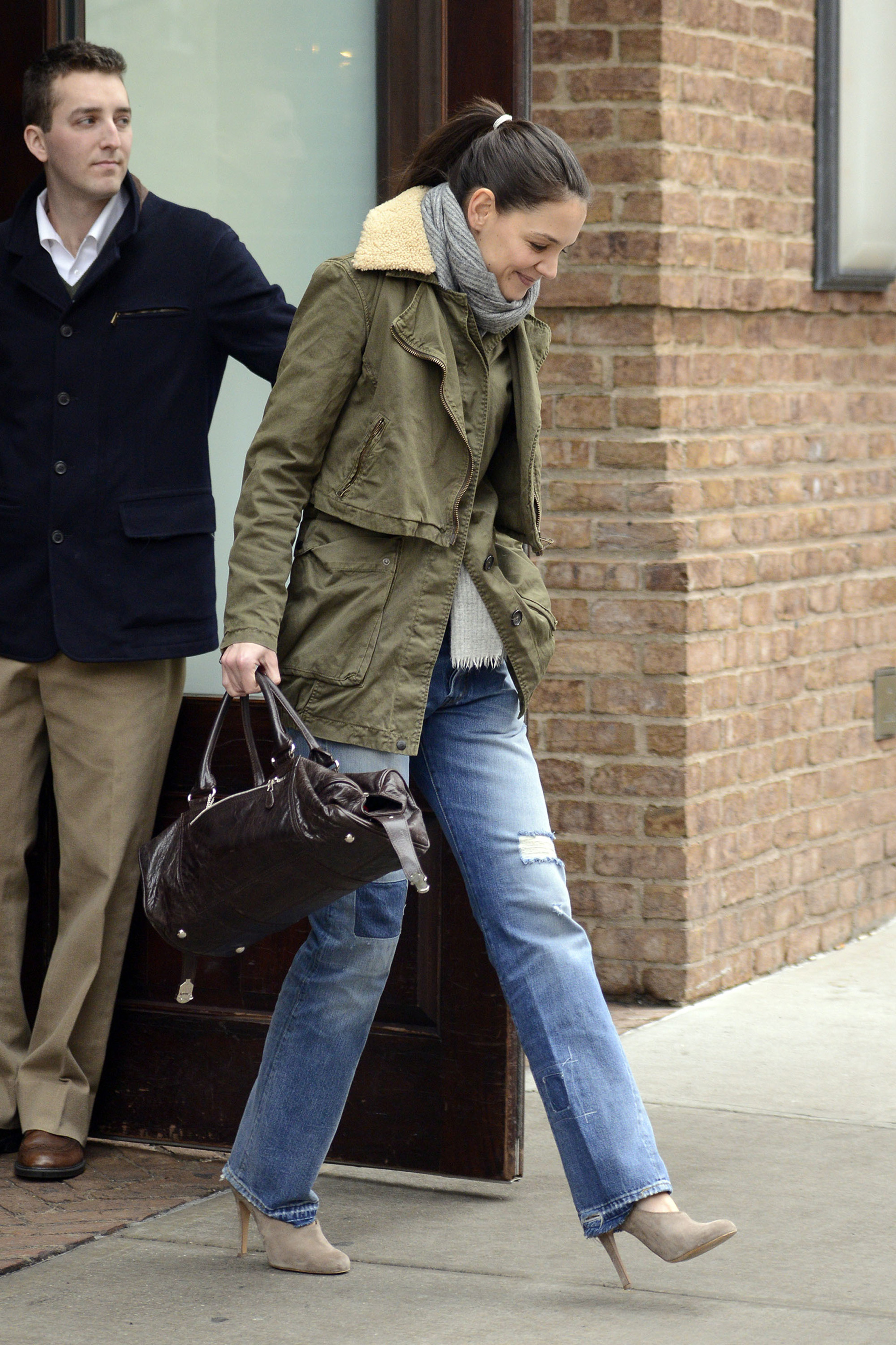 Katie Holmes dresses up casual straight leg jeans with pumps