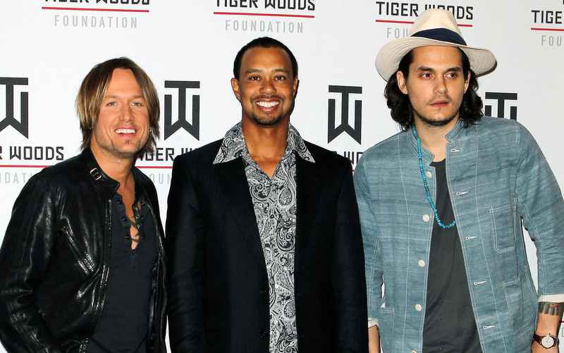 Keith Urban in 2011 posting with Tiger Woods and John Mayer