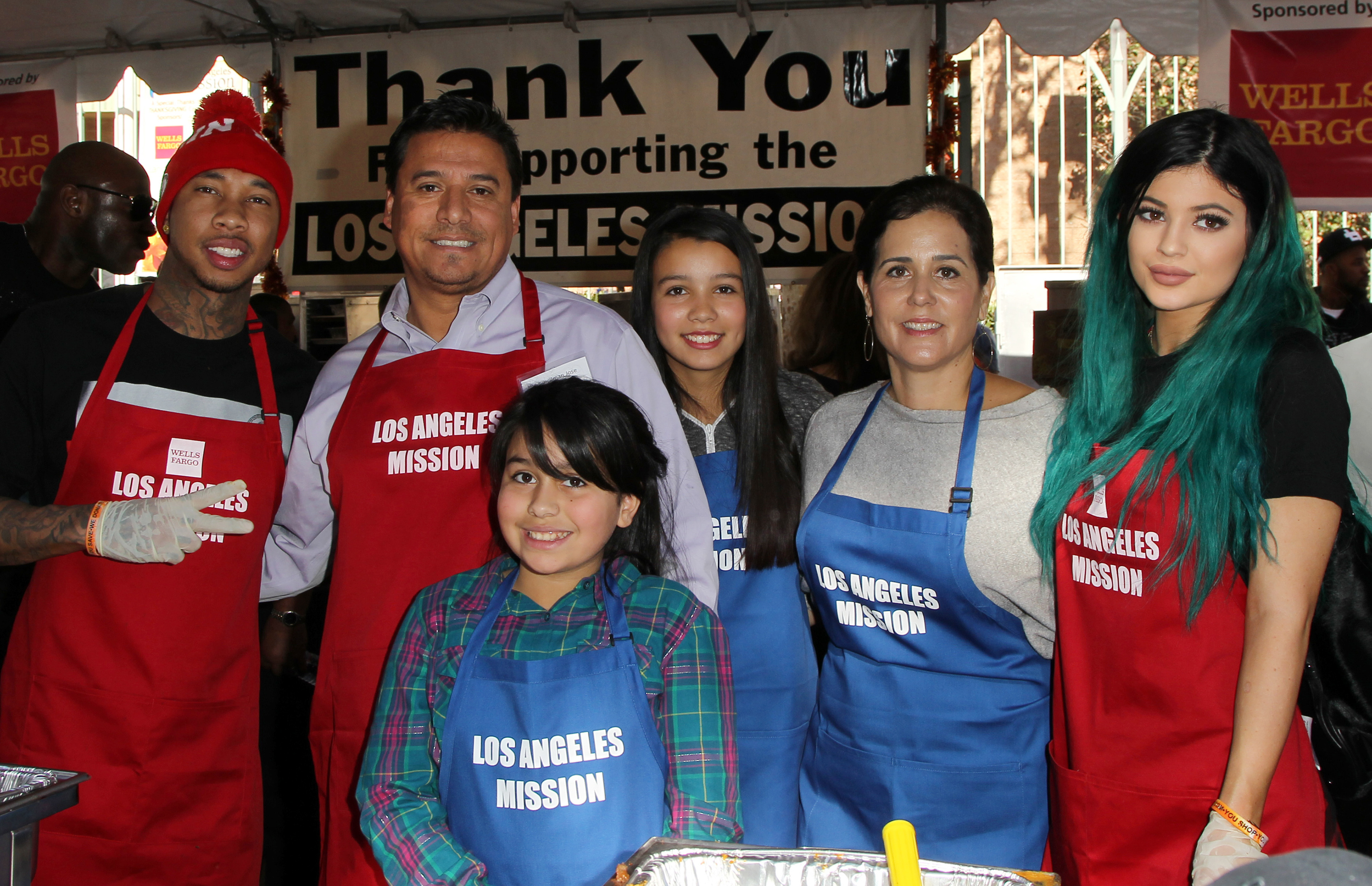 Kylie Jenner and Tyga at LA Soup Kitchen Thanksgiving 2014