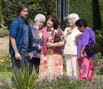 Luke Wilson gets a visit from his neighbors