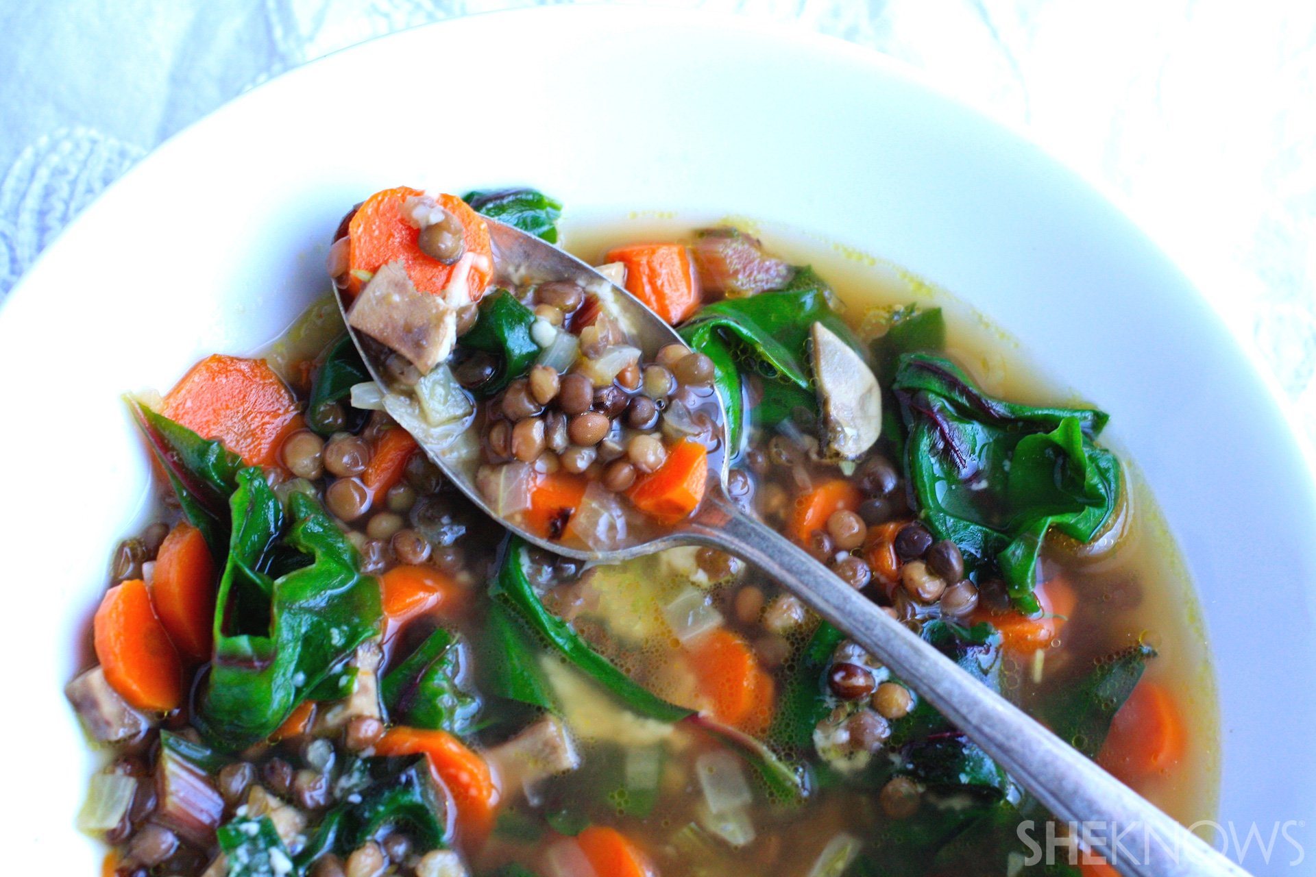 Chunky vegetable soup with roasted carrot, Swiss chard, and lentils