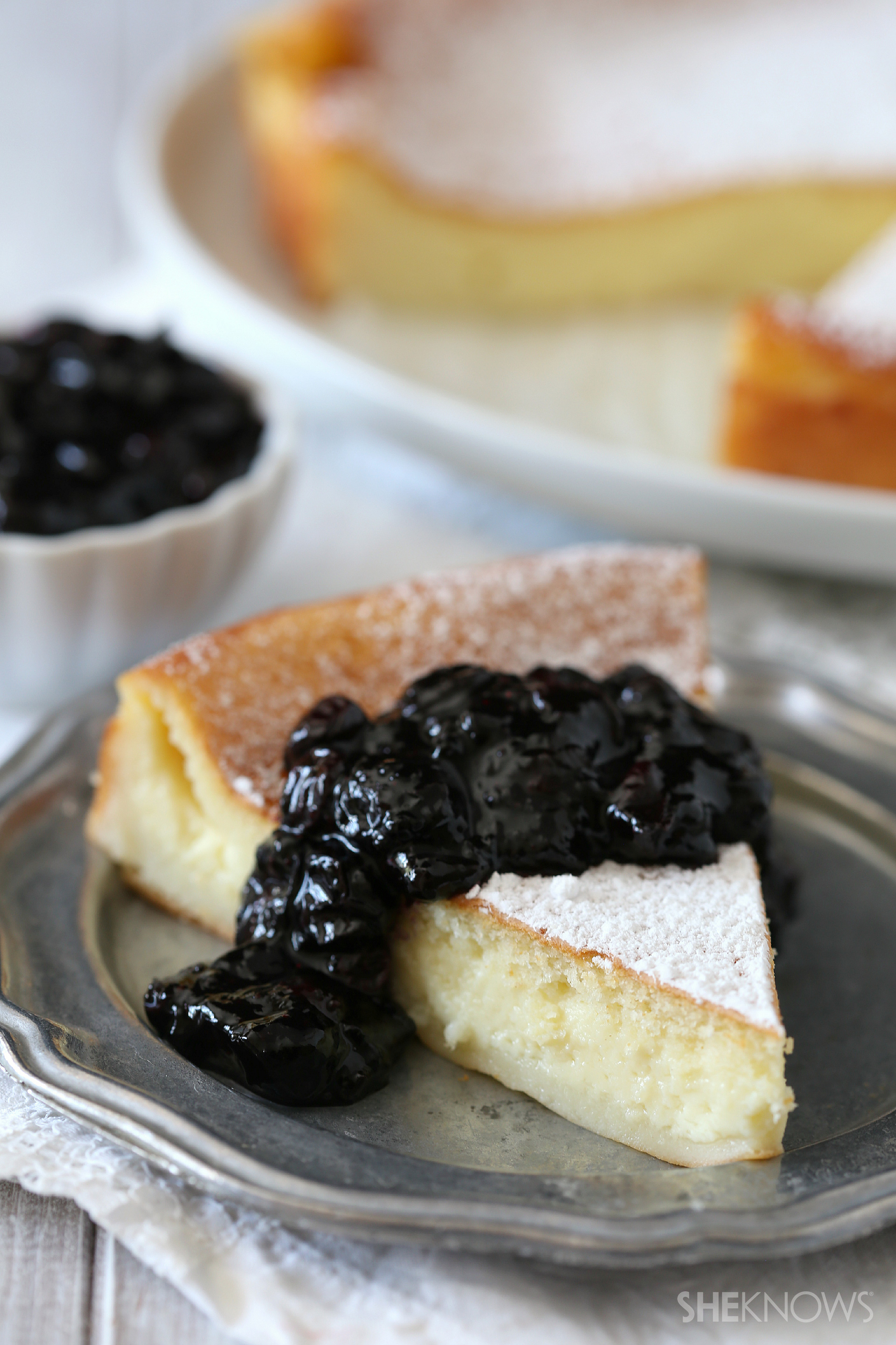 Magic cake topped with fresh berry compote