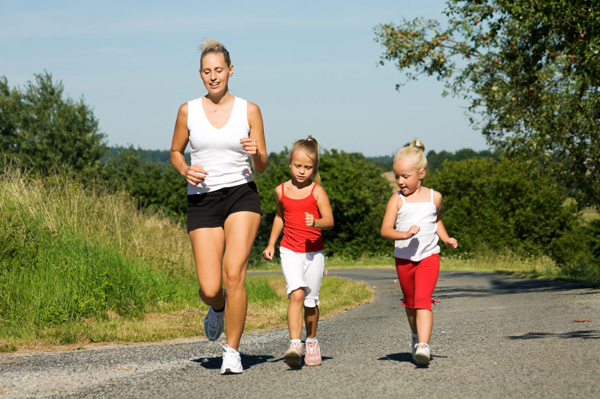 Mom running with daughters