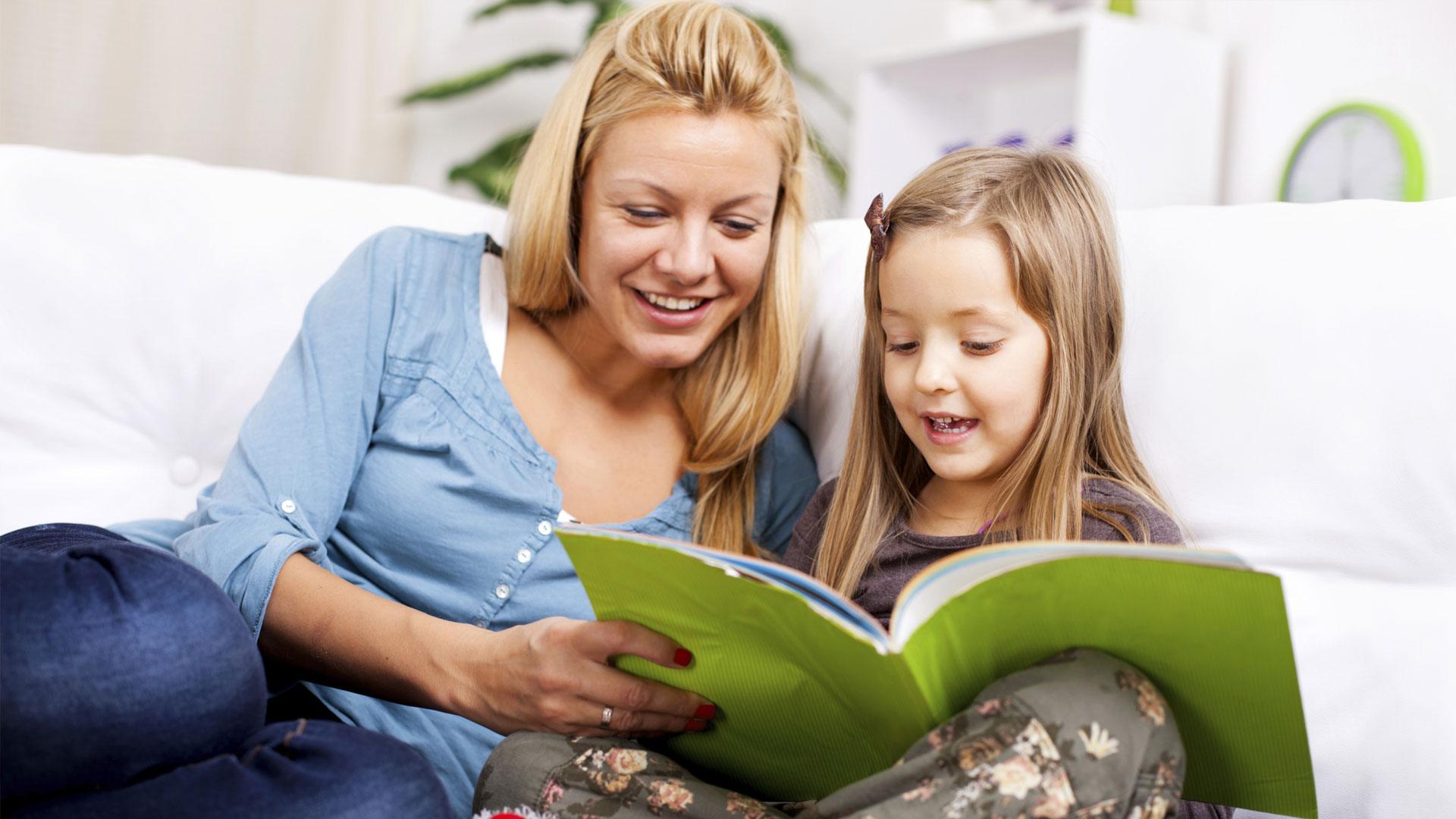 Mouther and daughter reading a book
