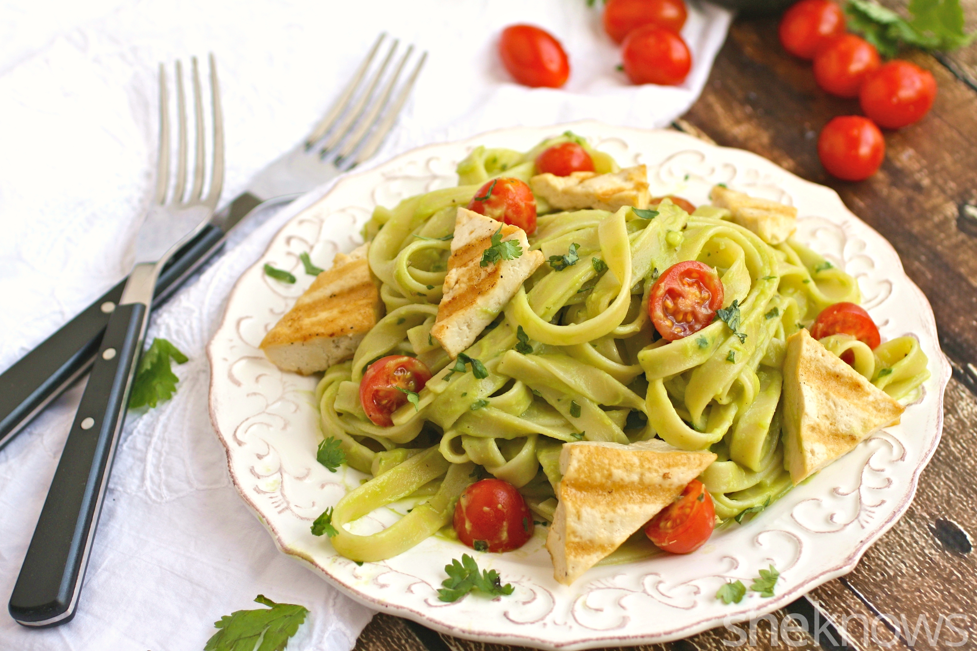 Enjoy this colorful meal: grilled tofu with cilantro-avocado noodles and cherry tomatoes for Meatless Monday