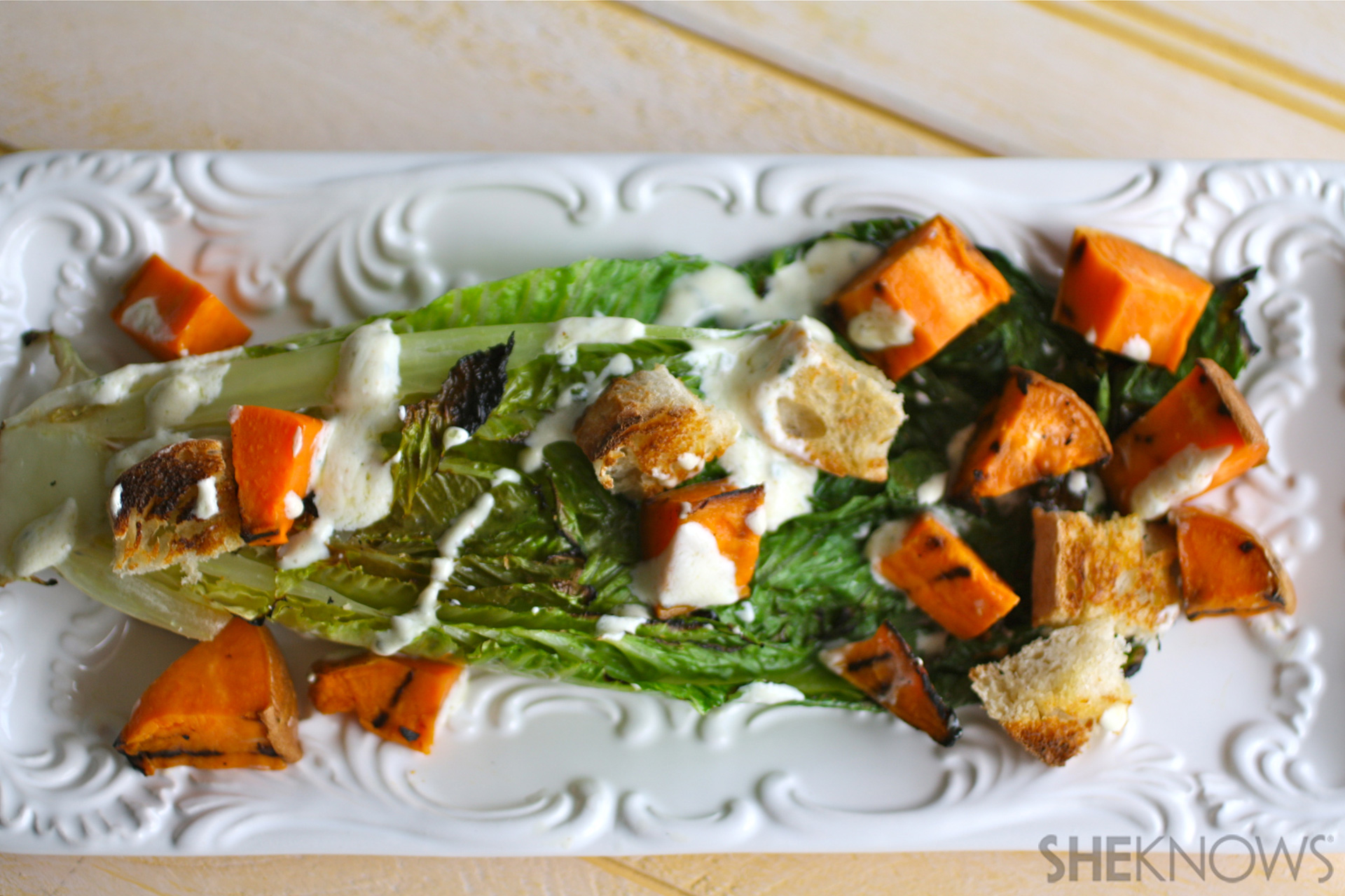 Grilled Romaine and sweet potato salad with creamy cilantro dressing