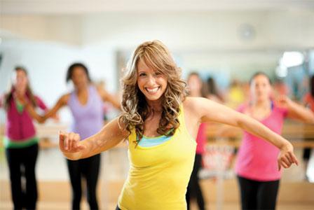 Smiling woman fitness dancing