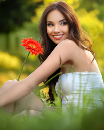Smiling young woman enjoying the spring