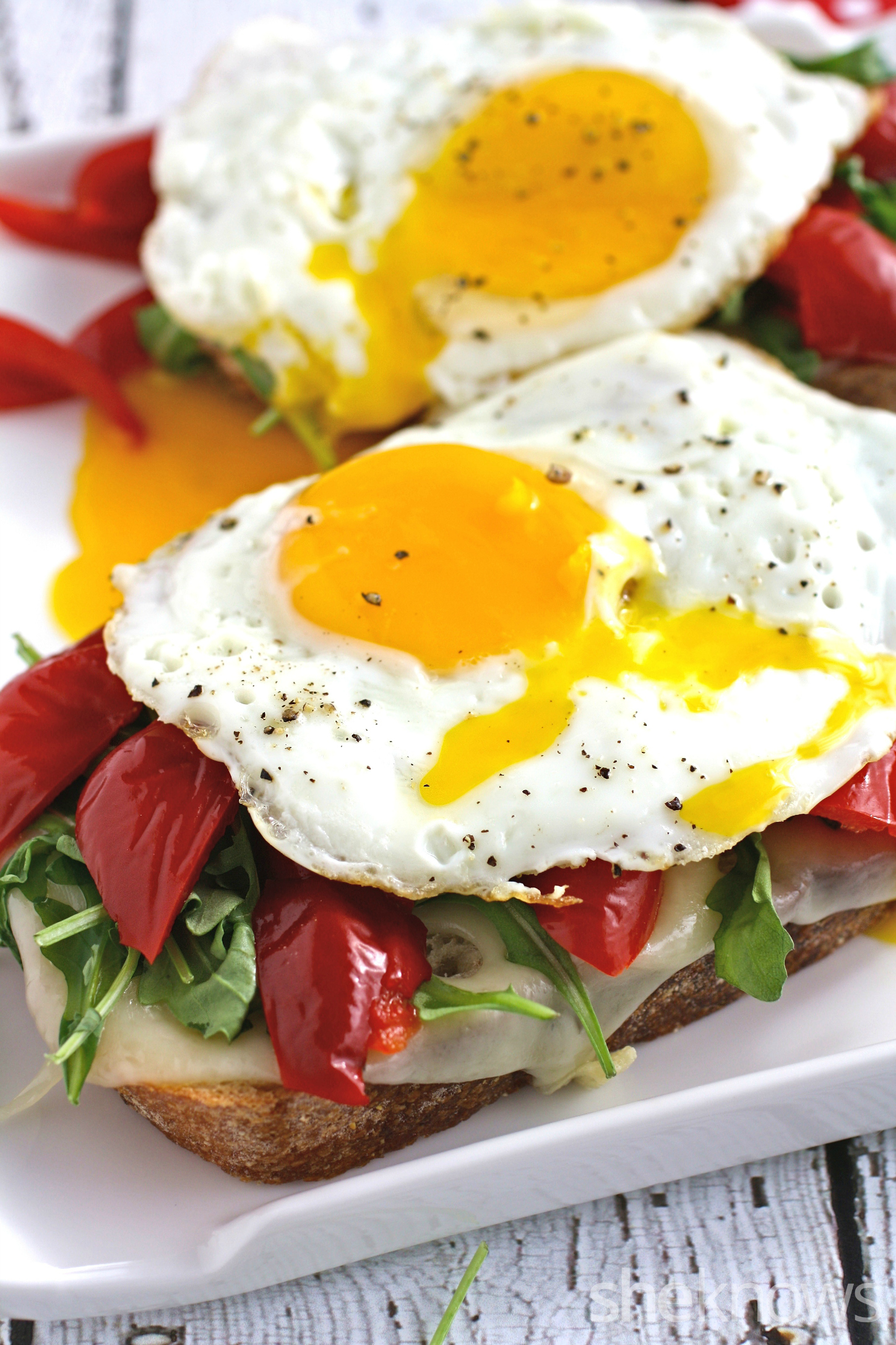 This grilled cheese sandwich with roasted red peppers, arugula, and fried egg is somthing special