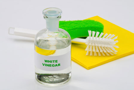 White vinegar and cleaning supplies
