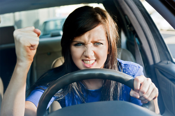 Woman having road rage