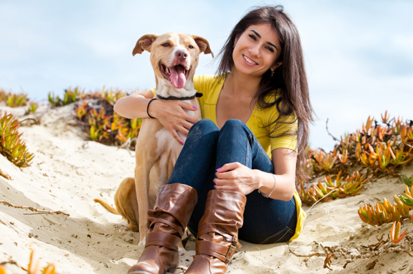 Woman outdoors with her pitbull terrier